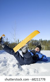 Middle-aged man falling to snow