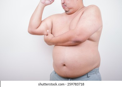 Middle-aged man holding a hand with excess fat. On a white background.