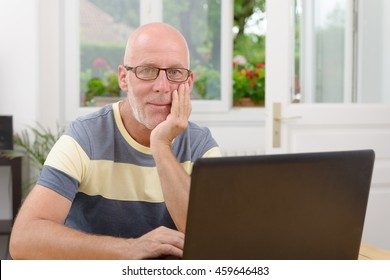 a middle-aged man with a laptop