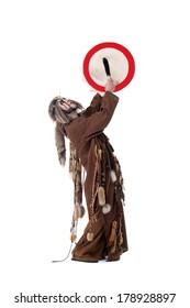 Middle-aged man posing as shaman in studio