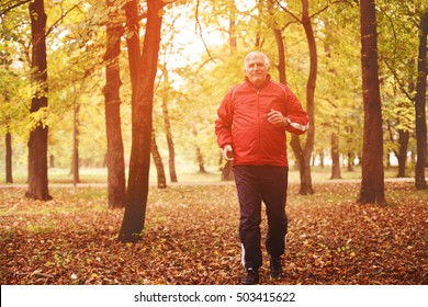 Middle-aged man running in the park.