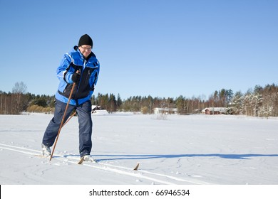 Middle-aged man skiing