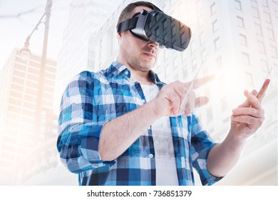 Middle-aged man in VR headset working on tablet