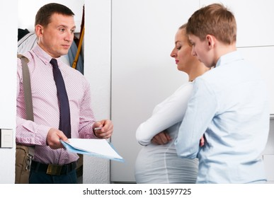 Middle-aged mother and son struggling to pay utility bills and rent for apartment