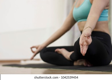 A middle-aged woman does yoga. Yoga in the studio.