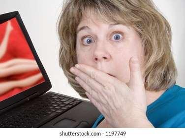Middle-aged woman looks aghast at what is showing on her computer. Photo composite.