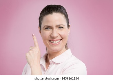 middle-aged woman shows emotional expressions in front of a pink background