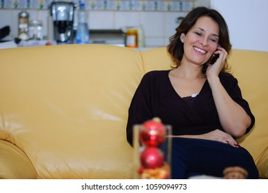 Middle-aged woman sitting in her apartment