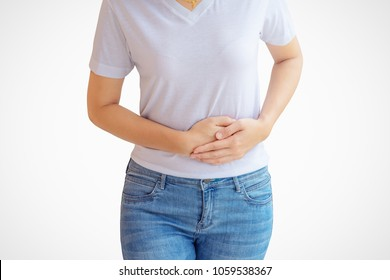 Middle-aged woman stomachache on white wall background.