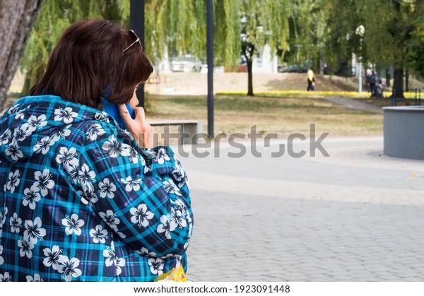 middleaged-woman-windbreaker-speaks-on-6