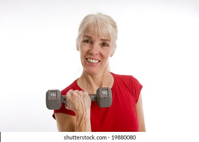 Middle-aged woman working with barbell isolated against white background