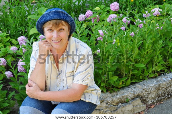 Middle-aged woman working in the garden