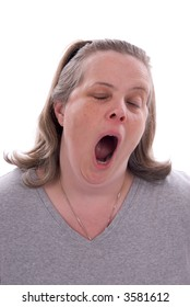 Middle-aged woman yawning isolated over a white background