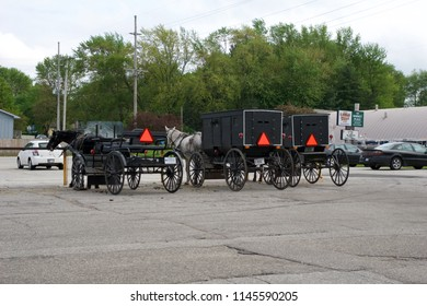 MIDDLEBURY, INDIANA, UNITED STATES - MAY 22nd, 2018: View of amish carriage along the city, known for simple living with touch of nature contacy, plain dress, and reluctance to adopt conveniences of
