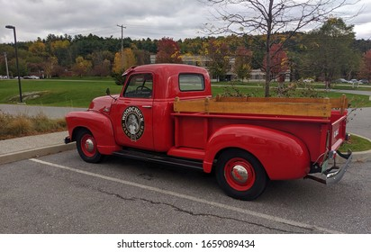 Middlebury, Vermont /USA - October, 4, 2020: A red antique pickup that is outside a cidery.