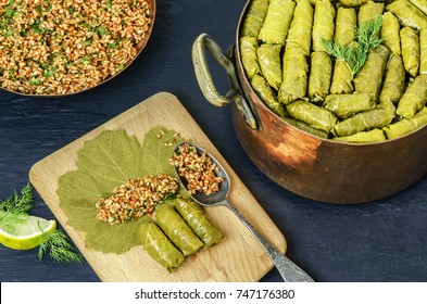 Middle-Eastern Food, Arabian cuisine, preparing stuffed vine leaves, or traditional Dolma.Top view, close up.