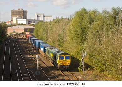 MIDDLESBROUGH, NORTH YORKSHIRE, UK - OCTOBER 9, 2012: Freightliner Class 66 No. 66570 heads east through Middlesbrough, hauling its train of intermodal freight towards the nearby Teesport.