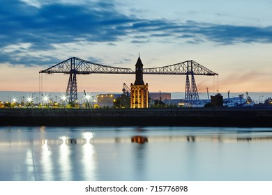 Middlesbrough Transporter Bridge and Dock Clock tower illuminated at dusk