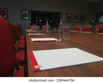 Middlesbrough, Tyne and Wear, England - 9th May 2019: Strategy meeting at Middlesbrough Football club. Conference table set up with stationary and water glasses ready for a business meeting.