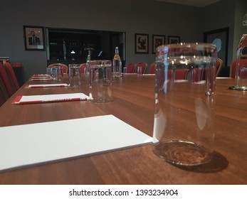 Middlesbrough, Tyne and Wear, England - Strategy meeting at Middlesbrough Football club in UK - tables, chairs, pencils and water all ready for a business meeting within the football directors suite o