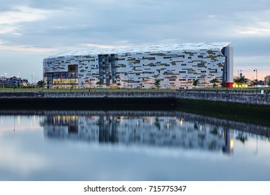 MIDDLESBROUGH UK- 5TH JUNE 2015; Middlesbrough college reflected in docks illuminated at dusk