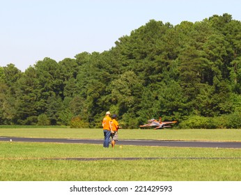 MIDDLESEX, VA - SEPTEMBER 27, 2014: A JetCat 180RX Ultralightning RC at takeoff at Hummel field airport in the wings wheels and keels annual show at the Hummel airfield airstrip in Middlesex VA