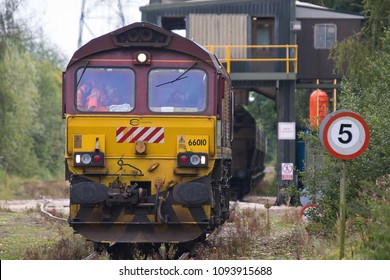 MIDDLETON, NORFOLK, UK - SEPTEMBER 14, 2012: Euro Cargo Rail-liveried DBS Class 66 No. 66010 runs around its train of hoppers under the loading silo at Middleton Towers, for a cargo of sand for Goole.