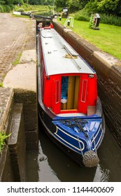 MIDDLETON, WARWICKSHIRE, UK - JUNE 27, 2017: Black Buck, a sixty foot narrow boat undertaking a cruise of the Black Country Ring, navigates the locks at Middleton in North Warwickshire.