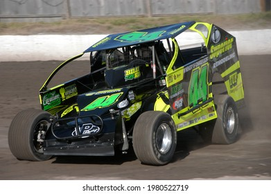 Middletown, NY, USA - June 13, 2020: Short track racer Anthony Perrego hustles his Dirt Modified stock car around the dirt track at Orange County Fair Speedway.