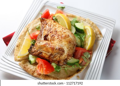 Mid-east style barbecue chicken. Originally an Egyptian dish but now very popular in Israel and other parts of the Middle East, the chicken is marinaded in lemon and spices and served