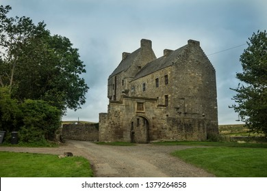 Midhope castle (Lallybroch in Outlander series) in Scotland with beautiful landscape and greenery.