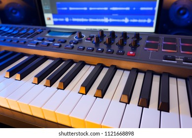 MIDI Keyboard in a computer music studio.