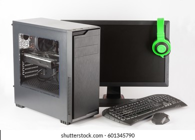 Midi tower computer case with led monitor, keyboard, mouse and headphones on white background, new, modern gaming PC