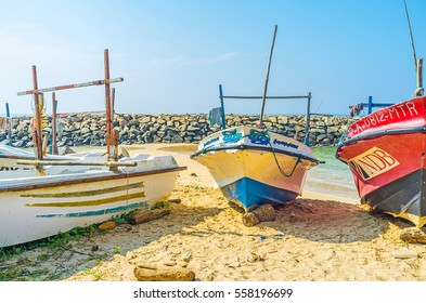 MIDIGAMA, SRI LANKA - DECEMBER 3, 2016: The fishing boats are the main landmark of the sand beach, on December 3 in Midigama.