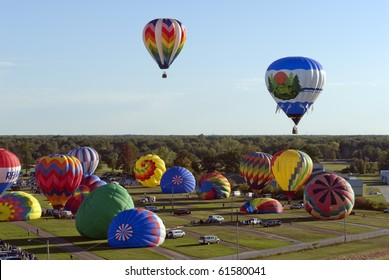MIDLAND, MICHIGAN-SEPTEMBER 17:  Hot air balloons participate in the 20th annual Balloon Festival fly on September 17, 2010 over Midland, MI countryside. This year 65 balloons participated.