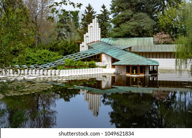 MIDLAND, MICHIGAN,USA-APRIL 29: Alden B. Dow home and Studio, reflecting in a pond at Dow Gardens in daytime, on April 29, 2017. The home and studio are available for tours