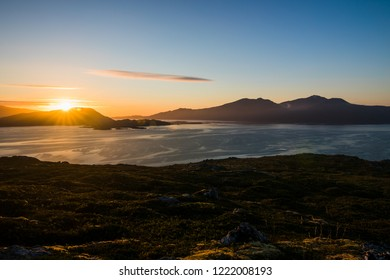 Midnight sun with a blue sky in Norway on the Lofoten islands