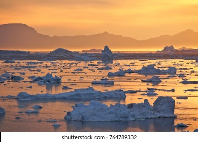Midnight Sun and icebergs in Disko Bay, Ilulissat, West Greenland