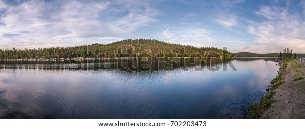 Midnight sun in Lapland.Tranquil lake view.