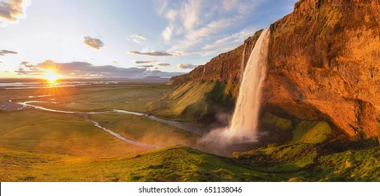 The midnight sun lights up Seljalandsfoss waterfall in southern Iceland.