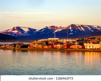 Midnight sun on the Longyearbyen waterfront in Svalbard in the Norwegian arctic