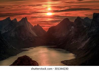 Midnight sun over Reinebringen. Summer in the Lofoten in Norway