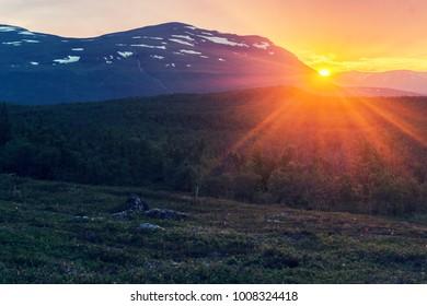 Midnight sun in summer in the Abisko National Park, Sweden