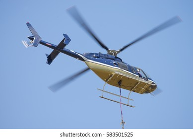 MIDRAND, SOUTH AFRICA-FEBRUARY 13 2016: A Bell 407 helicopter  being used by Eskom during insulator maintenance on 400kV lines