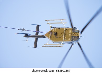 MIDRAND, SOUTH AFRICA-FEBRUARY 13 2016: Linesmans view of a Bell 407 helicopter  during insulator maintenance on 400kV lines