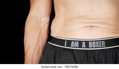 Midriff of a man wearing a boxer shorts with the message I am a boxer.