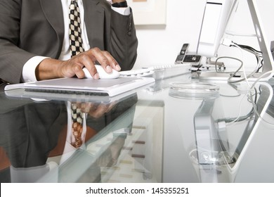 Midsection of a businessman using computer at office