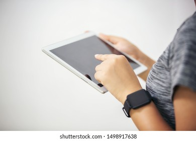 Midsection Of Businessman Using Digital Tablet With Chart Against White Background