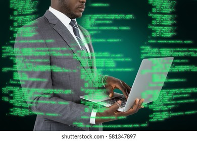 Midsection of businessman using laptop against green background with vignette