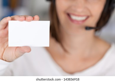 Midsection of businesswoman holding blank visiting card